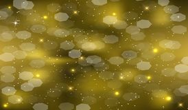 Golden background with shiny sparks and stars. Evening festive gold background with shining sparks and stars, Christmas Stock Photo