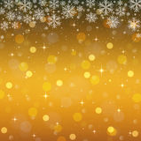 Golden background with snowflakes. Christmas light Royalty Free Stock Photos