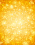 Golden background with snowflakes, vector Stock Photography