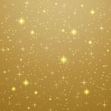Golden background with stars Stock Photography