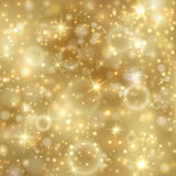 Golden background with stars and twinkly lights Royalty Free Stock Image