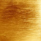 Golden background. Texture with some fine grain in it Royalty Free Stock Photo