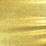 Golden background. Texture with some fine grain in it Royalty Free Stock Image