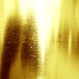 Golden background. Texture with some fine grain in it Royalty Free Stock Images