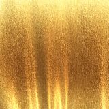 Golden background. Texture with some fine grain in it Stock Photos