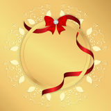 Golden background with yellow circular ornament, round tag and red ribbon with a bow and a diamond. Royalty Free Stock Photography
