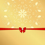 Golden background with yellow ornament red ribbon and bow. Royalty Free Stock Photo