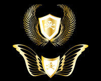 Golden badge. With eagle wings and butterfly Stock Photography