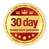 Golden badge with red fill and 30 day money back g Stock Image