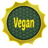 Golden badge with VEGAN text. Royalty Free Stock Photography