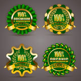 Golden badges with laurel wreath Stock Images