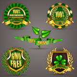 Golden badges with laurel wreath. Set of luxury gold badges, shields with floral laurel wreath, ribbon. 100 % premium organic, eco friendly, gmo free. Emblem Stock Photography