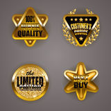 Golden badges with laurel wreath Stock Photo
