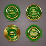 Golden badges. Set of luxury gold badges with laurel wreath, star, wax seal. 100 % pure organic natural product, guaranteed. Eco emblem, bio icon, logo, label Vector Illustration