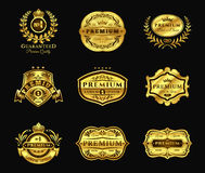 Golden Badges, stickers premium quality isolated on black Royalty Free Stock Photography