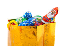 Golden bag with Christmas candy Royalty Free Stock Photo