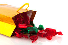Golden bag with Christmas candy Stock Images