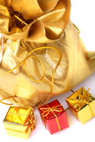 Golden bag with gift boxes Royalty Free Stock Photos