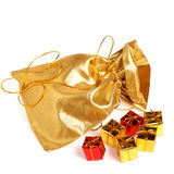 Golden bag with gift boxes Stock Photography