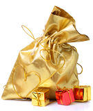 Golden bag with gifts Stock Image