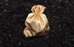 Bag of money is on the ground. Golden bag with the money on the ground stock photo