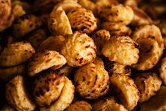 Golden baked coconut balls closeup royalty free stock images