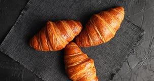 Golden baked croissants on napkin Royalty Free Stock Photos