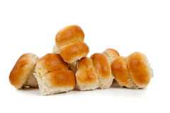 Golden baked dinner rolls on a white background royalty free stock images
