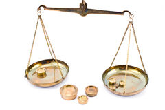 Golden balance scales with weights Stock Photos