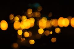 Golden ball with black background. Or gold bokeh light blurs Stock Images
