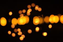 Golden ball with black background. Or gold bokeh light blurs Royalty Free Stock Photo