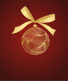 Golden ball with bow on red. Background Royalty Free Stock Photos