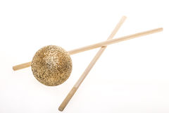 Golden Ball with chopsticks Royalty Free Stock Images