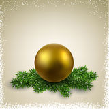 Golden ball on christmas eve branches. Royalty Free Stock Photo