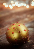 Golden ball with christmas lights Royalty Free Stock Photo