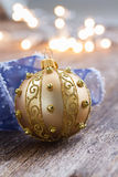 Golden ball with christmas lights Royalty Free Stock Photography
