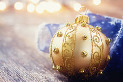Golden ball with christmas lights Stock Photos