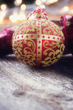Golden ball with christmas lights Royalty Free Stock Photos