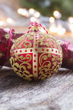 Golden ball with christmas lights Stock Photography