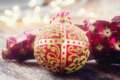Golden ball with christmas lights Stock Images