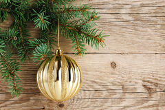 Golden ball on christmas tree Royalty Free Stock Photos