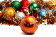 Golden ball on the Christmas tree Stock Photos