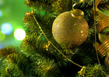 Golden ball on the Christmas tree branch Royalty Free Stock Photos