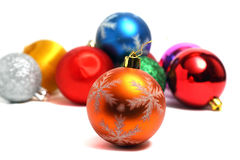 Golden ball on the Christmas tree on of colorful ba Stock Image