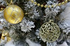 Golden ball on the Christmas tree stock photo