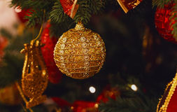 Golden ball on Christmas tree Royalty Free Stock Images