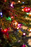 Golden ball decorates the Christmas tree royalty free stock photos