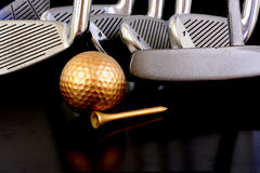 Golden ball and Irons Royalty Free Stock Photo