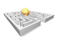The golden ball is in a maze. The golden ball in the maze is shown in the image Stock Photo