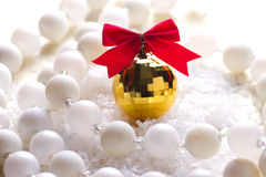 Golden ball with a red bow Stock Photo